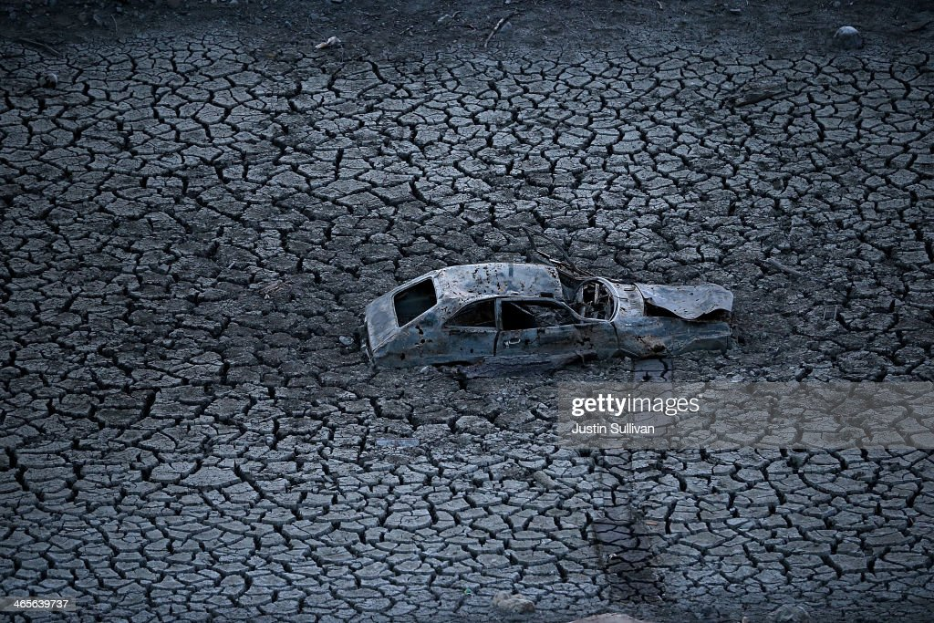 A car sits in dried and cracked earth of what was the bottom of the Almaden Reservoir on January 28 2014 in San Jose California Now in its third...