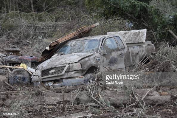 A car sits in ruins in the aftermath of a mudslide and related flooding on March 25 2014 in Oso Washington A massive mudslide on March 22 has killed...