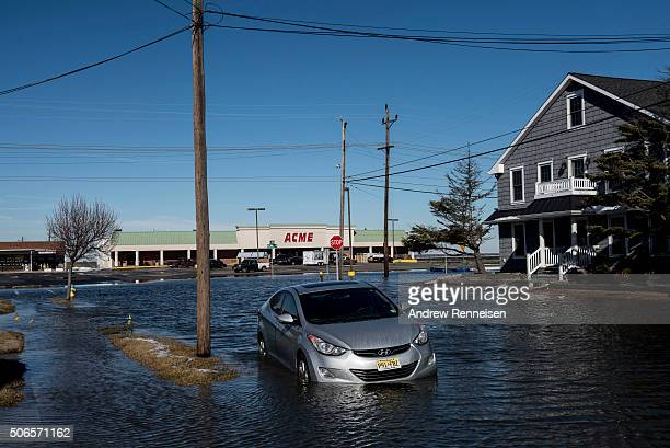 A car sits on a flooded street after a blizzard hit the region on January 24 2016 in North Wildwood New Jersey A major snowstorm hit the East Coast...