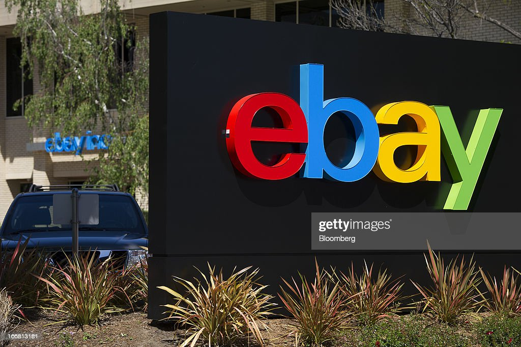 A car sits parked behind EBay Inc. signage displayed at the company's headquarters in San Jose, California, U.S., on Tuesday, April 16, 2013. Ebay Inc. is expected to release earnings data on April 17. Photographer: David Paul Morris/Bloomberg via Getty Images
