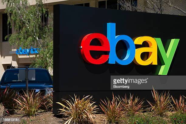 A car sits parked behind EBay Inc signage displayed at the company's headquarters in San Jose California US on Tuesday April 16 2013 Ebay Inc is...