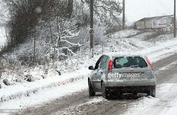 A car skids in the snow on the normally busy A367 between Bath and Peasedown St John on January 18 2013 near Bath England Heavy snow is bringing...