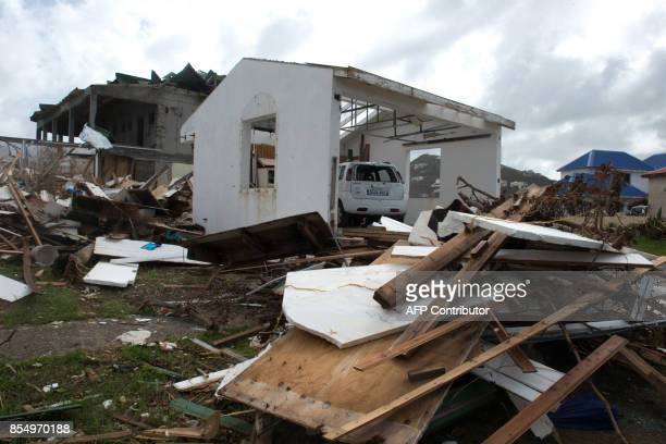 A car stand parked in a garage surrounded by debris in Oyster Pond on the French Caribbean island of SaintMartin three weeks after the passing of...