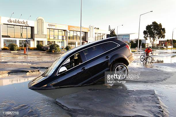 A car stands in water on Ferry Road after two magnitude 60 and 55 earthquakes struck on June 13 2011 in Christchurch New Zealand The aftershocks have...