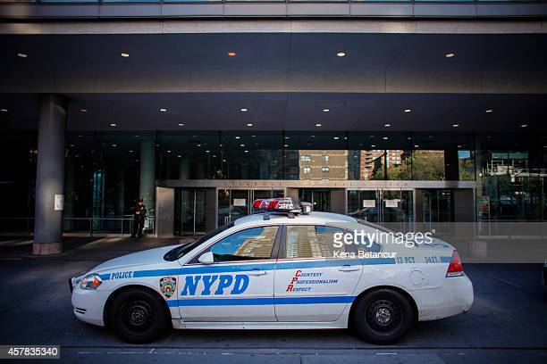 NYPD car stands outside the Bellevue Hospital where Dr Craig Spencer who was diagnosed with the Ebola disease remains in quarantine on October 25...