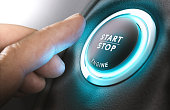 Car stop start system with finger pressing the button, horizontal image