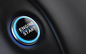 Car start button on dashboard. Engine start writes on push button. Horizontal composition with copy space and selective focus.
