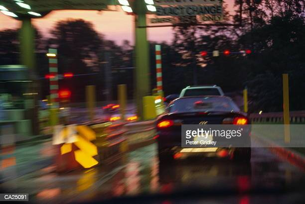 Car stopped at toll booth, rear view (soft focus)