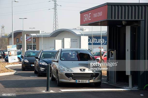 A car stops to order food at the drivethru of Paul Bocuse's 'Ouest Express' fast food restaurant on March 13 2014 in VillefranchesurSaone France...