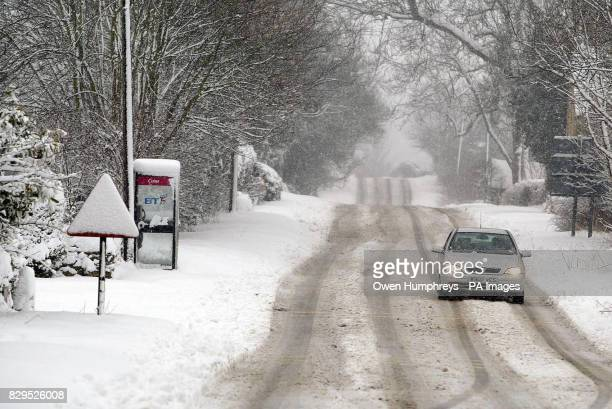 A car struggles along the road near Scotch Corner in deep snow as bad weather persists across the county Heavy snow fell across parts of Britain...