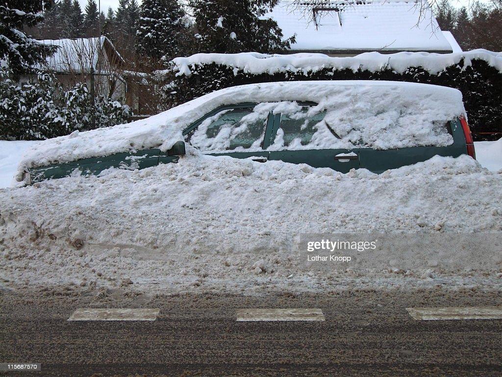 Car stuck in snow piles