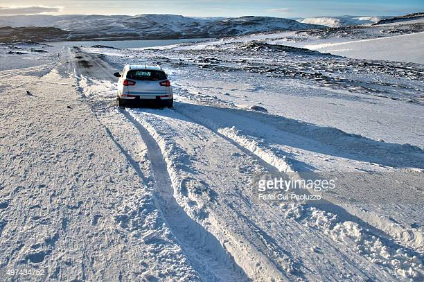Car stuck in snowy road at Drangsnes Westfjords Iceland