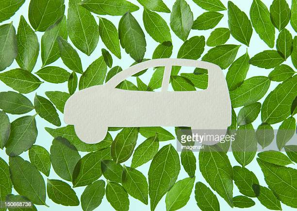 Car surrounded with leaves (Ecology image)