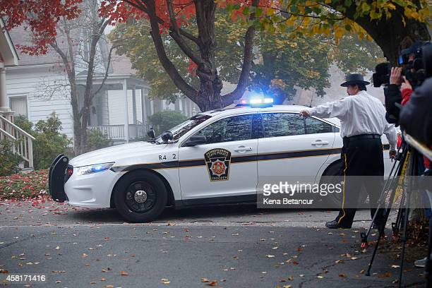 A car that carrying Eric Frein arrives for his first arraignment to court on October 31 2014 in Milford Pennsylvania Frein a suspected cop killer was...