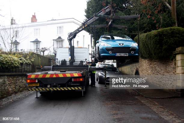 A car that was parked over a drain in Canynge Road Clifton Bristol is lifted and parked a few feet away to allow police to examine the drain