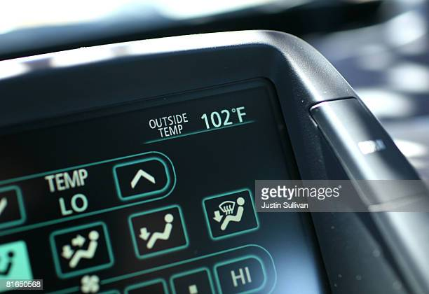 A car thermometer displays an outside temperature of 102 degrees June 20 2008 in Petaluma California Northern and Southern California are both...