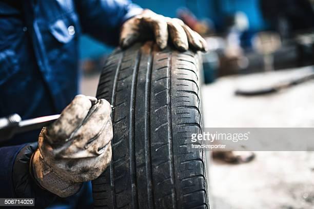 car tire repairmen with caliber