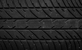 old pile of a worn out car tires pattern background