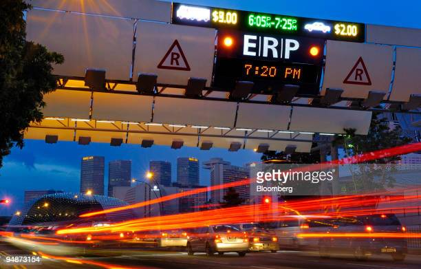 Car traffic travels past the Electronic Road Pricing gantry in the central business district of Singapore on Tuesday July 22 2008 CapitaCommercial...