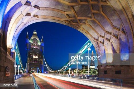 Car trails on Tower bridge; London; England