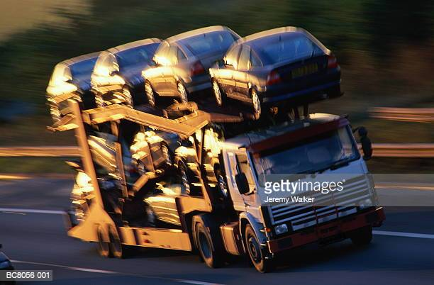 Car transporter with full load, on motorway (blurred motion)