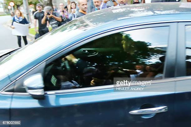 A car transporting former Brazilian chief of staff Jose Dirceu leaves the federal courthouse in Curitiba Brazil on May 3 2017 Brazil's Supreme Court...