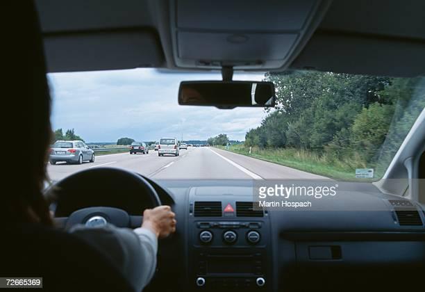 Car traveling on multiple lane highway