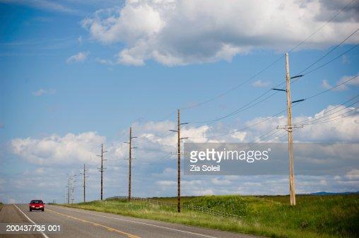 Car traveling on rural road