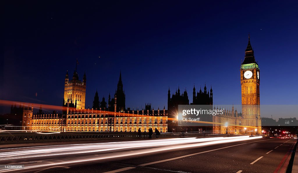A car travels along Westminster Bridge past the Houses of Parliament on March 27, 2012 in London, England.
