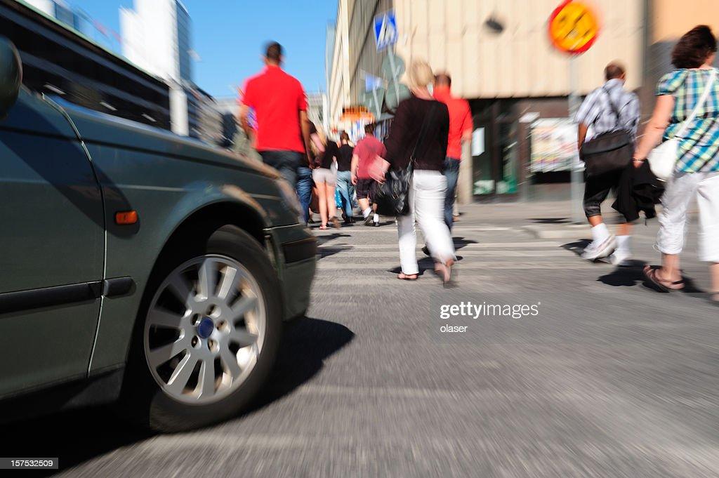 Car turning on zebra crossing