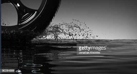 Car tyre creating water splash