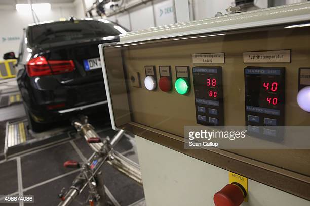 A car undergoes standard emissions testing under laboratory conditions during a workshop for media on automobile emissions at the DEKRA testing...