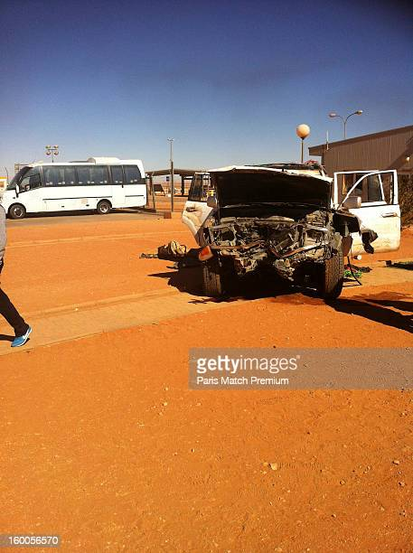 A car used by jihadists to ram than entrance at the Algerian gas site of Tinguentourin is seen in a photograph taken on a by an unnamed hostage with...