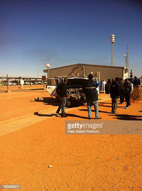 A car used by jihadists to ram than entrance at the Algerian gas site of Tinguentourin is seen in a photograph taken by an unnamed hostage with his...