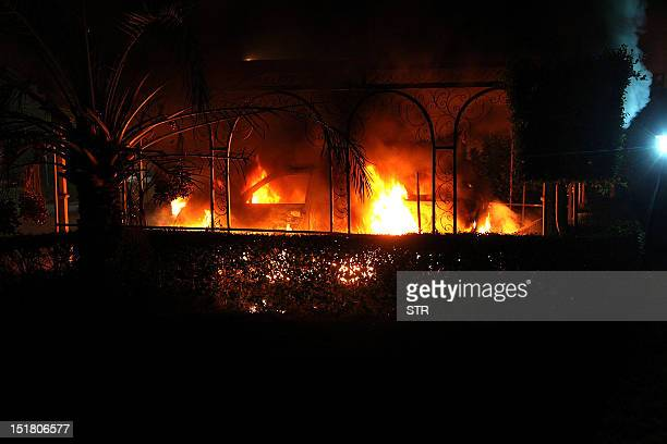 A car vehicle burns after it was set on fire inside the US consulate compound in Benghazi late on September 11 2012 An armed mob protesting over a...