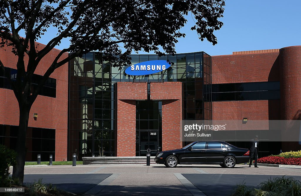 A car waits in front of a Samsung Electronics office on July 30, 2012 in San Jose, California. The trial in the Apple Inc. and Samsung Electronics Co. patent battle begins today at a San Jose federal courthouse to determine if Samsung illegally copied technolgy used in Apple's popular iPhone and iPads. Apple is seeking $2.5 billion in damages.