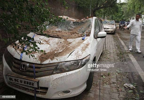 A car was damaged after the wall collapsed near Imperial Hotel during a sudden thunderstorm on May 30 2014 in New Delhi India At least nine people...