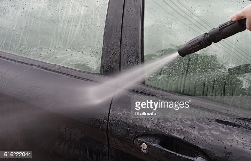 Car Washing. Cleaning Car Using High Pressure Water : Stock Photo