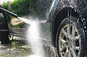 Washing black car with high pressure washer