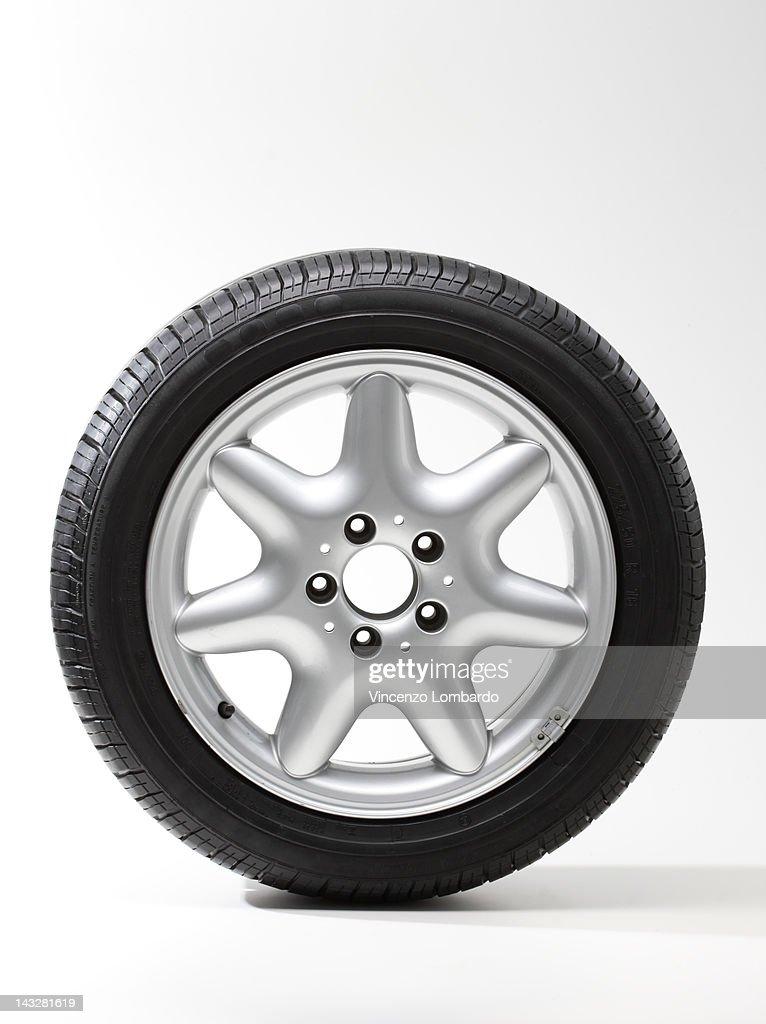 Car wheel, white background : Stock Photo