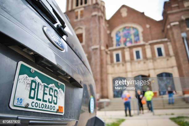 A car with a 'Bless' license plate parked out front at the opening of the International Church of Cannabis on April 20 2017 in Denver Colorado The...