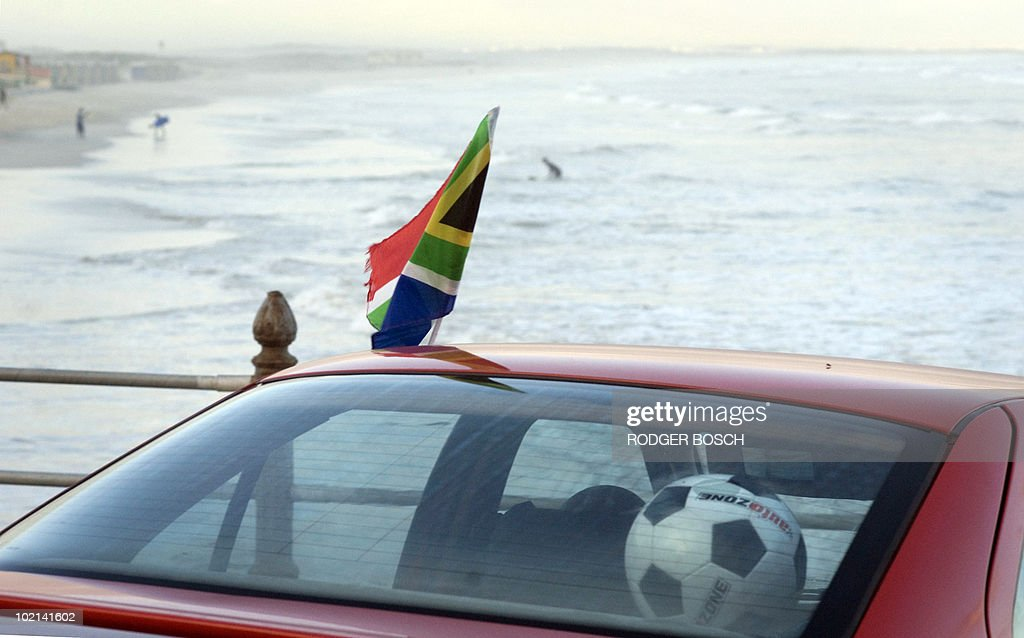 A car with a South African flag is parked at Muizenburg Beach, a popular surfing spot in Cape Town, on 16 June, 2010 moments before South Africa take on Uruguay in their World Cup Group A football match.