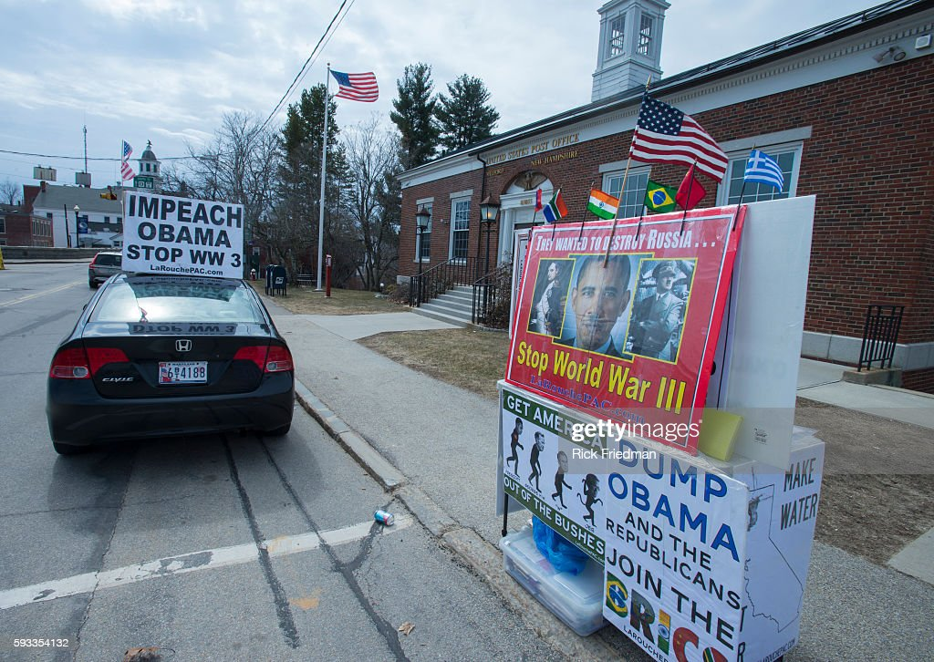 A car with and 'Impeach Obama' sign parked near where Senator Rand Paul speaking at town hall in Milford NH during his presidential announcement tour...
