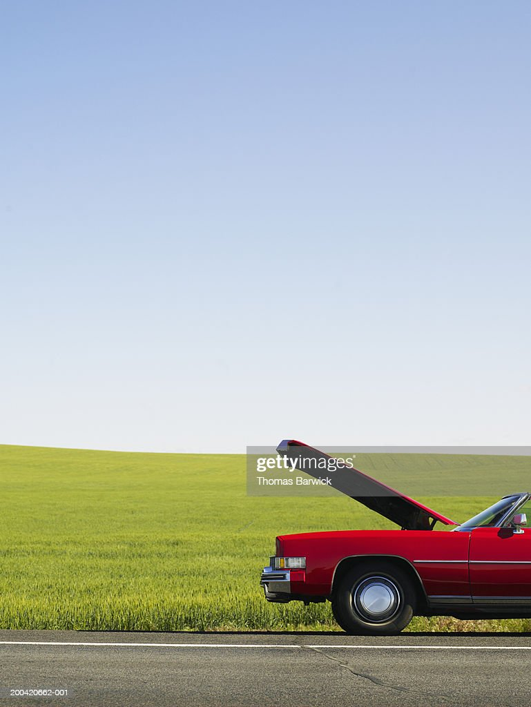 Car with hood up on side of road : Stock Photo