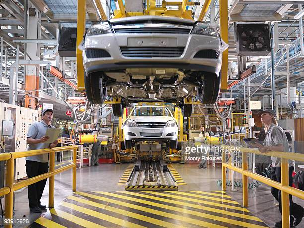 Car Workers Inspecting Production Line