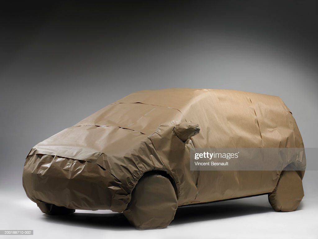 Car wrapped in brown paper : Stock Photo