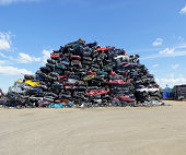 piled up compressed cars going to be shredded