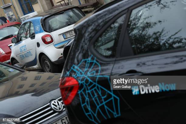 Car2Go and DriveNow cars stand parked in a street in the city center on November 14 2017 in Berlin Germany A number of companies have plunged into...