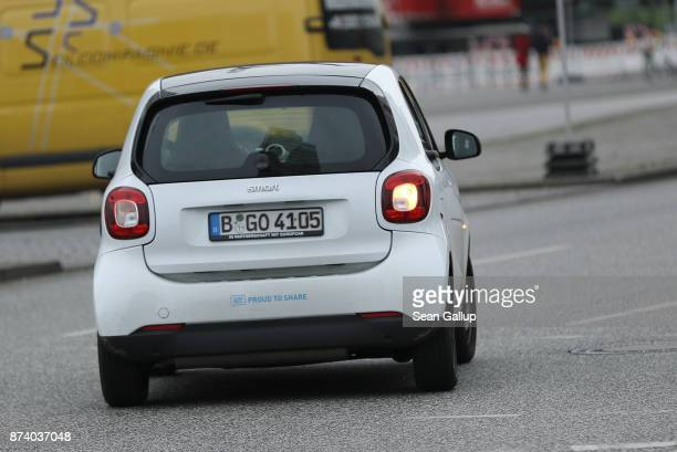 Car2Go car drives in the city center on November 14 2017 in Berlin Germany A number of companies have plunged into the market for sharing Berlin's...