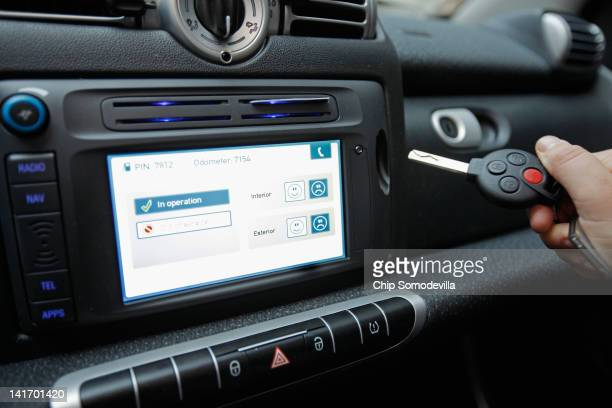 A car2go empoloyee demonstrates how the car's key is stored in the dashboard during a press preview March 22 2012 in Washington DC Beginning March 24...